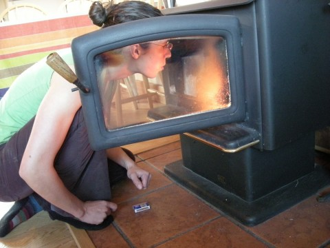 Maria tending the wood stove, Twisp, WA, October 2009